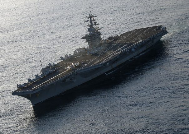 Stowaway French cops in hot water after jumping aboard US aircraft carrier