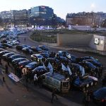 Missed flights and traffic chaos as mini-cab drivers protest in Paris