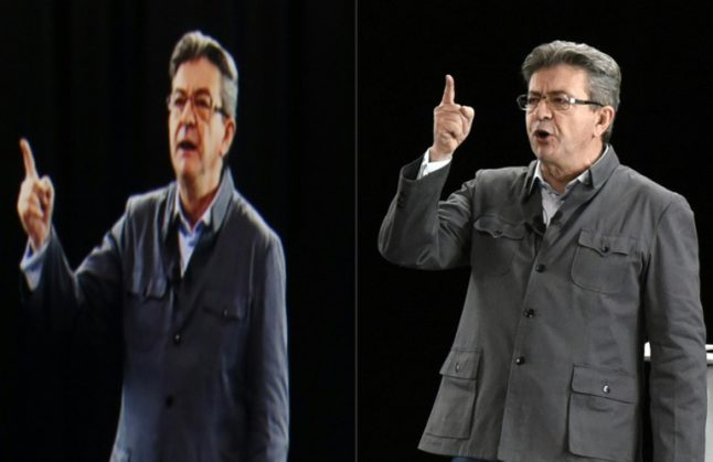 Presidential candidate appears by hologram at French election rally