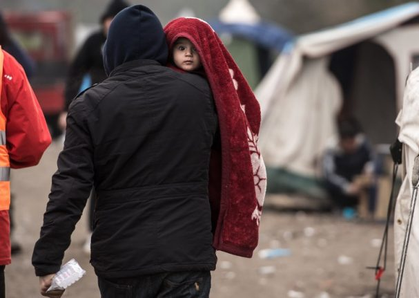 Hollande slams Britain over refusal to take young migrants from France