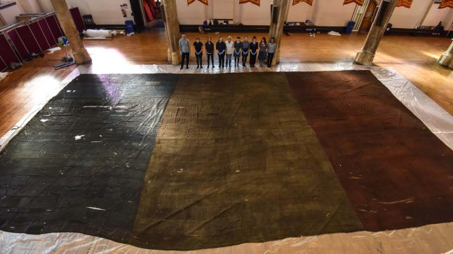 Tennis court-sized French flag unfurled at UK castle