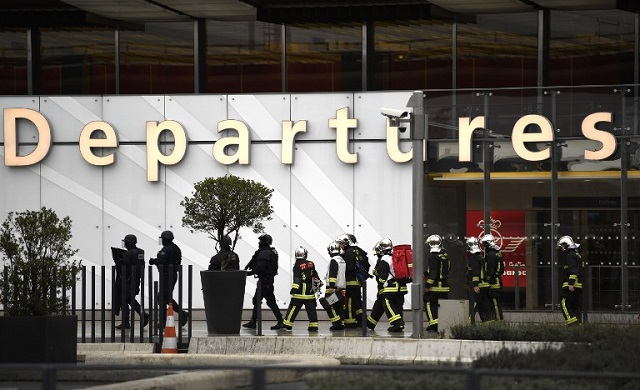 Flights resume at Orly airport as investigators question attacker's family