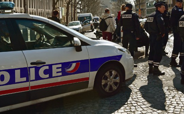 Man held after his father and brother found with throats slit in Paris