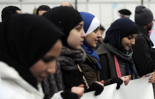 French firms told they can ban staff from wearing Muslim headscarves at work