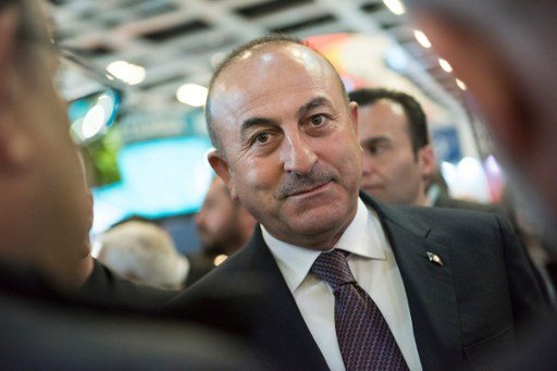 Turkish foreign minister expected in France as Dutch rally row rages