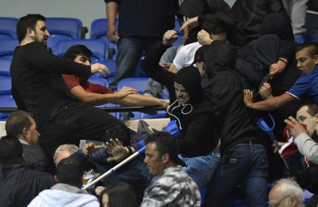 Football: Violence in the stands and a pitch invasion mar Lyon vs Besiktas match