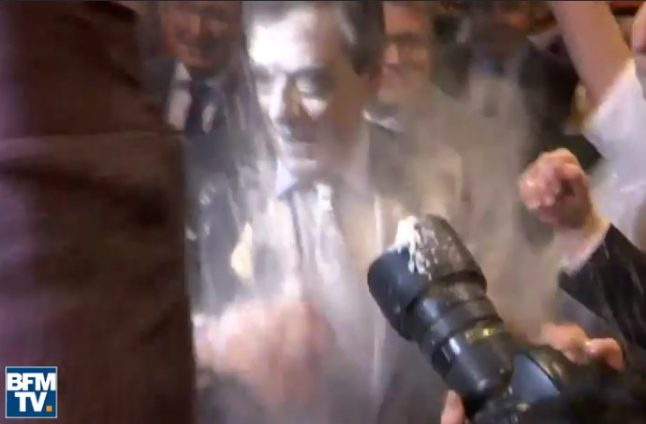 Fillon (and his suit) hit by flour power at campaign rally