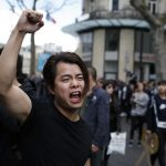 Clashes as thousands march in Paris over police killing of Chinese man