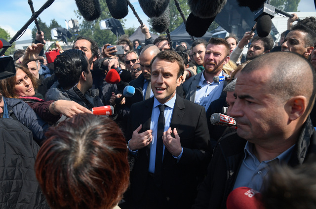 Emmanuel Macron finally wakes up in a factory car park in northern France
