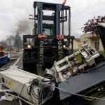 Angry French workers booby-trap factory, trash machines and threaten to blow the place up