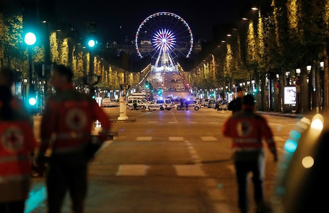Man charged over links to Champs-Elysees gunman