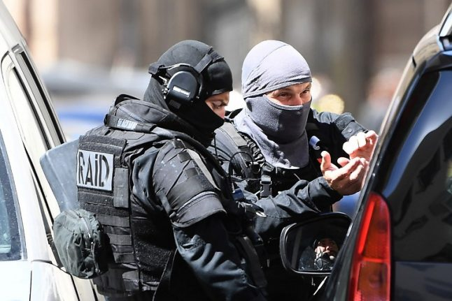 French anti-terror police seize heavy weapons and arrest five in raids: reports