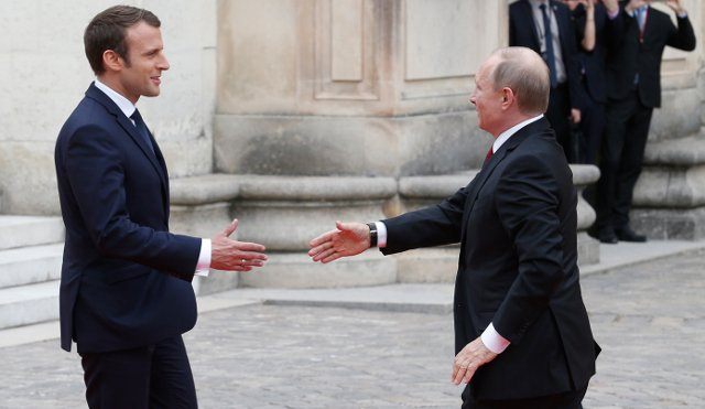Macron and Putin hold face-to-face talks in splendour of Versailles