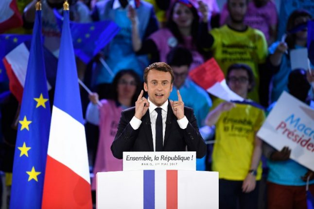 Macron wins majority in French parliament but record abstention mars election