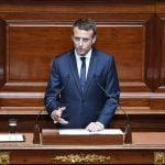 France is ready for 'radically new path', says Macron as he vows to slash French lawmakers by a third