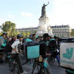 France's delivery bike riders take to the streets to protest salary changes