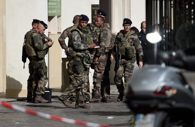 Man charged for ramming soldiers in Paris suburbs