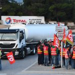 Roads and fuel depots blocked across France as truck drivers protest labour reforms