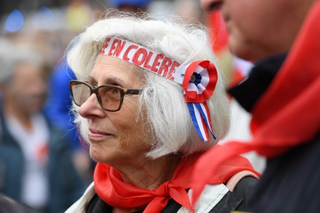 Angry French pensioners march against Macron
