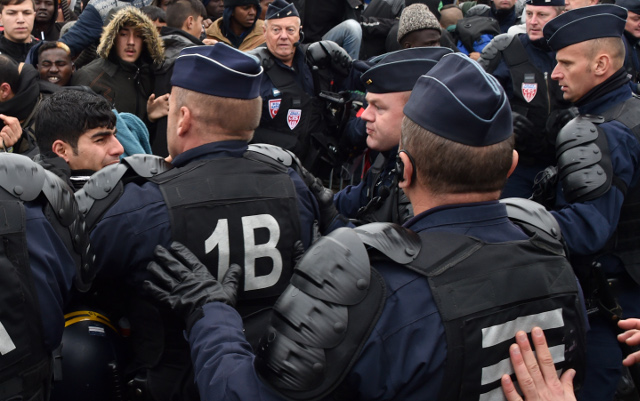 Beleaguered French riot cops booked in same hotel as migrants they evicted