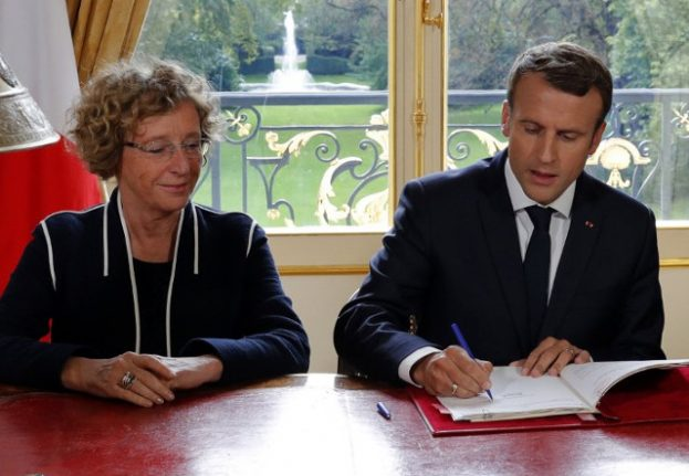 Defiant Macron signs his contested labour reforms into law