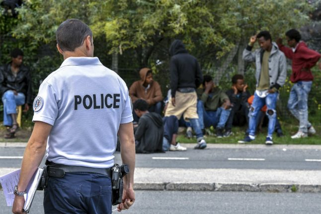 French police clash with migrants in Calais
