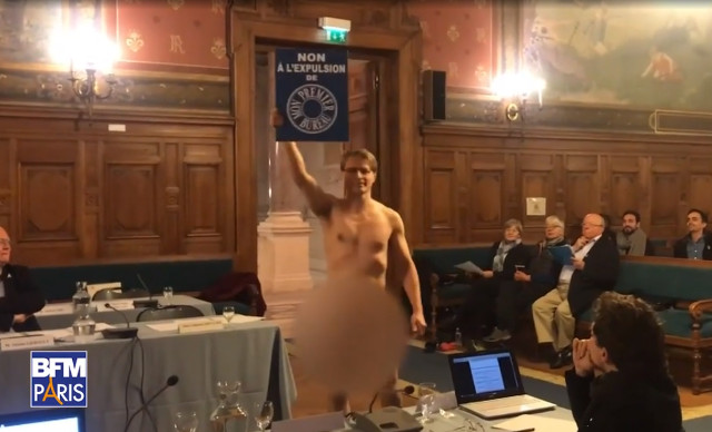 Only in France: Frenchman strips naked to protest at Paris council meeting