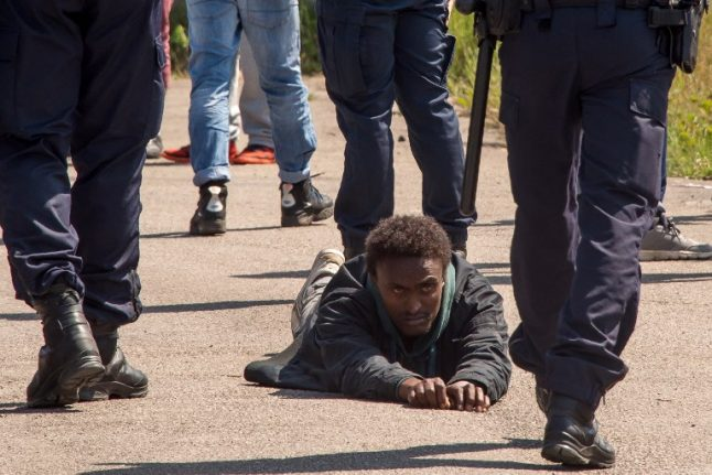 French policeman jailed for six months for slapping Calais migrant in face