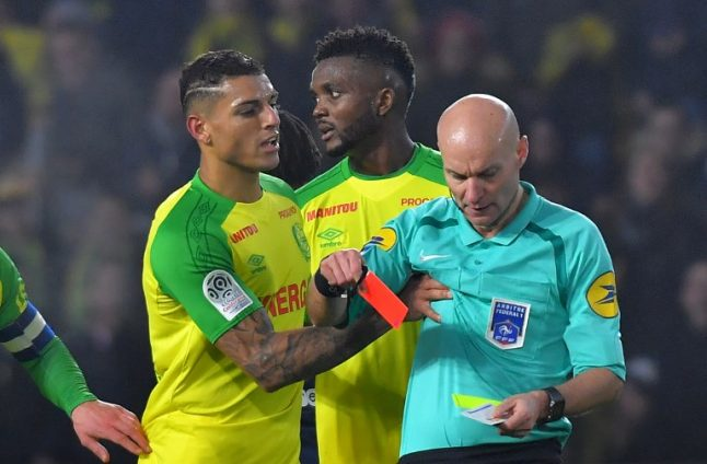 'It was clumsy': French referee sorry for kicking out at footballer
