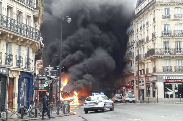 Probe opened after public bus burns to a cinder on Paris street