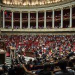 French lawmakers banned from wearing religious symbols... and football shirts in parliament