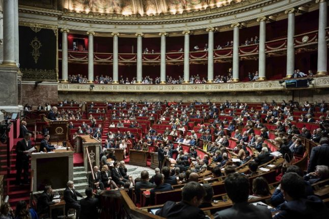 French lawmakers banned from wearing religious symbols… and football shirts in parliament