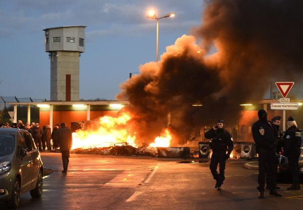 French prison guards hurt in new 'extremist' attack as wardens clash with riot police