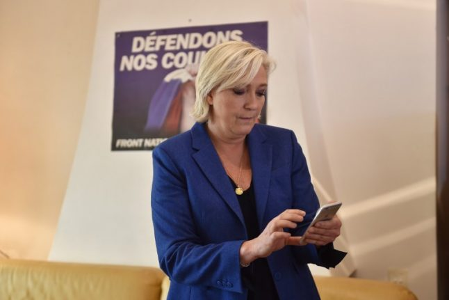 France's Marine Le Pen charged over 'shameful' tweets of Isis killings