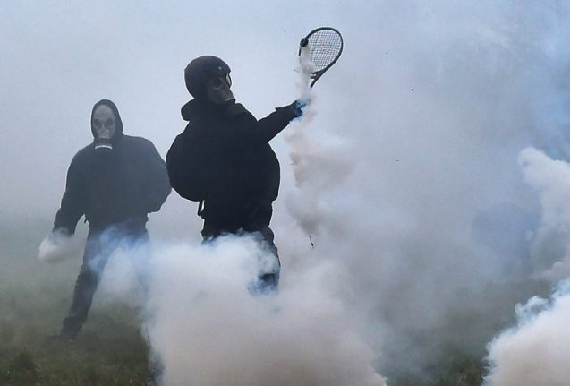 Tennis rackets against tear gas: Battle continues at French protest camp