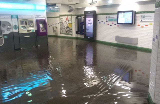 In Pictures: Torrential rain leaves Paris streets and Metro stations under water