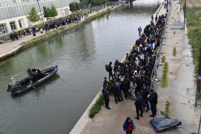In Pictures: Paris police clear out 1,700 migrants from canal camp