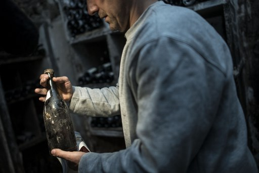 Sacré jaune! 244-year-old vintage wine sells for record €100,000 in France