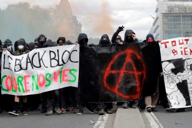 Who were the black-clad rioters in Paris and how can France stop them?