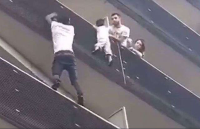 VIDEO: Paris 'spiderman' scales building to rescue dangling toddler