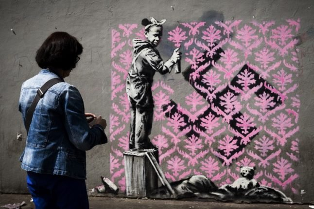 Banksy takes aim at French government with migrant mural blitz in Paris