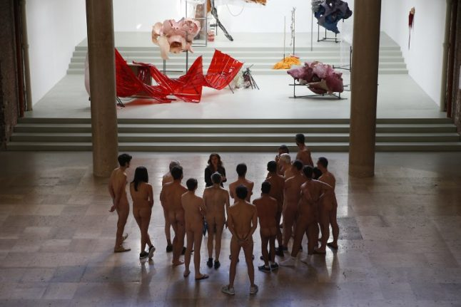 French nudists bare all for trips to 'no clothes' theme park and museums