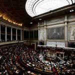 French MPs crack under pressure of Macron's energetic reform drive