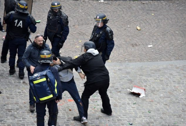 'I was just lending the police a hand,' says Macron's ex-security aide