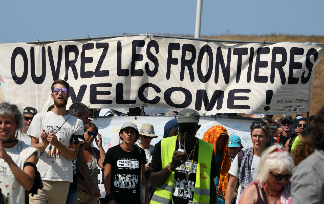 Four activists held in France for escorting migrants over border