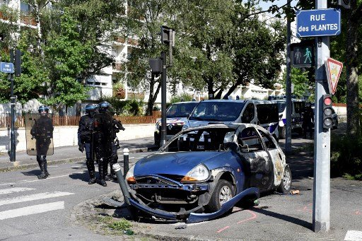 Nantes riots ease as family of victim shot by French cop plans lawsuit