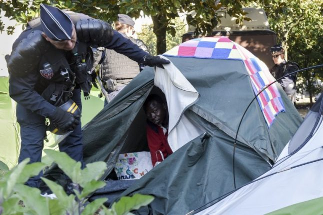 France adopts controversial asylum and immigration law