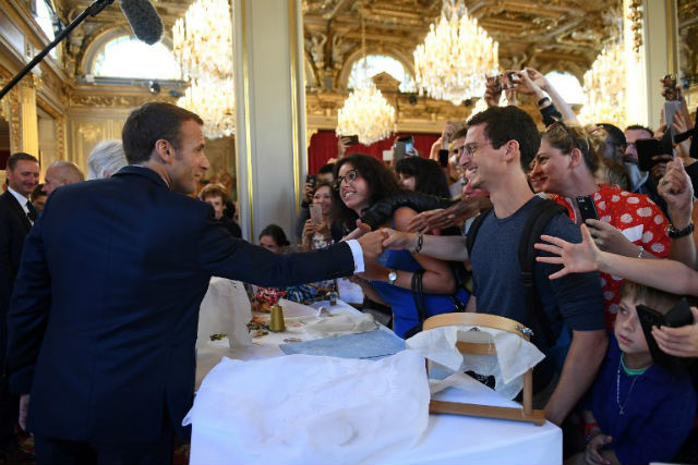 Macron dilutes pledge to end 'exit tax' on high earners