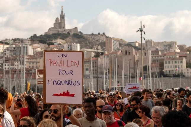 Thousands gather across Europe to back migrant rescue ship stuck in Marseille port