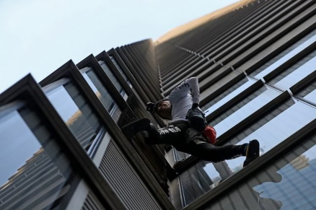 In images: 'French Spiderman' tower stunt grinds London's financial hub to halt
